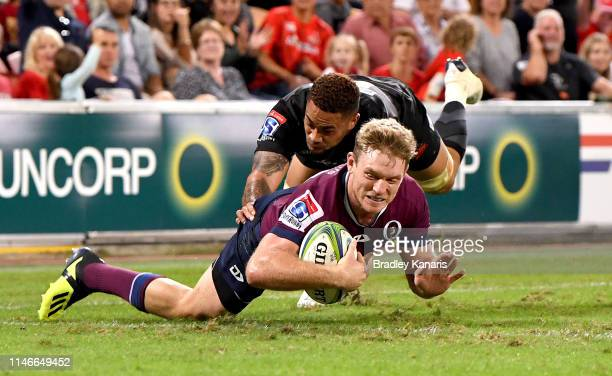 Bryce Hegarty of the Reds scores a try during the round 12 Super Rugby match between the Reds and the Sunwolves at Suncorp Stadium on May 03 2019 in...