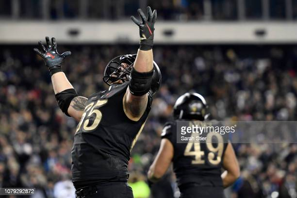 Bryce Holland of the Army Black Knights reacts after the Black Knights score a touchdown in the fourth quarter to win the game 1710 over the Navy...