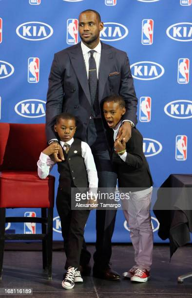 Bryce James LeBron James and LeBron James Jr attend the LeBron James press confernece to announce his 4th NBA MVP Award at American Airlines Arena on...