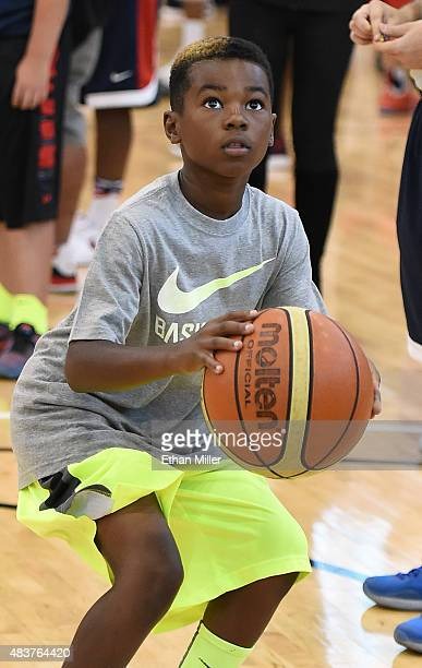 Bryce James son of LeBron James of the 2015 USA Basketball Men's National Team shoots during a practice session at the Mendenhall Center on August 12...