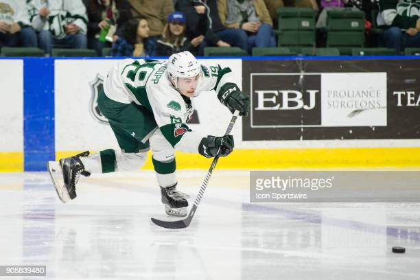 Bryce Kindopp of the Everett Silvertips fires a pass across the blue line during a game between the Everett Silvertips and the Portland Winterhawks...