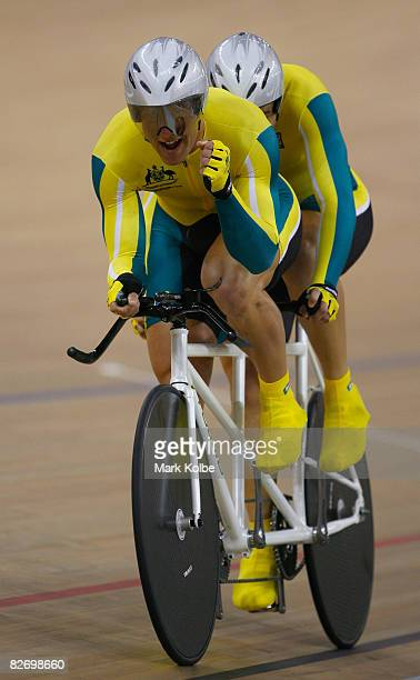 Bryce Lindores and his pilot rider Steven George of Australia celebrate after winning the bronze medal in the men's individual pursuit in the Track...