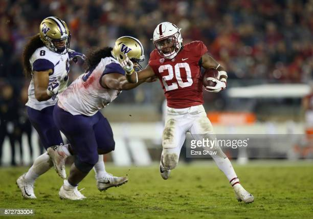 Bryce Love of the Stanford Cardinal breaks away from Vita Vea of the Washington Huskies at Stanford Stadium on November 10 2017 in Palo Alto...