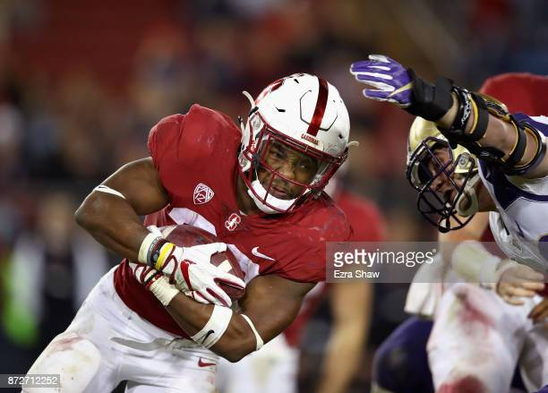 Bryce Love of the Stanford Cardinal runs with the ball against the Washington Huskies at Stanford Stadium on November 10 2017 in Palo Alto California