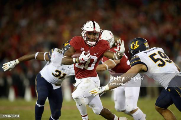 Bryce Love of the Stanford Cardinal runs with the ball against the California Golden Bears at Stanford Stadium on November 18 2017 in Palo Alto...