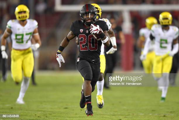 Bryce Love of the Stanford Cardinal scores on a sixty seven yard touchdown run against the Oregon Ducks during the first quarter of the NCAA football...
