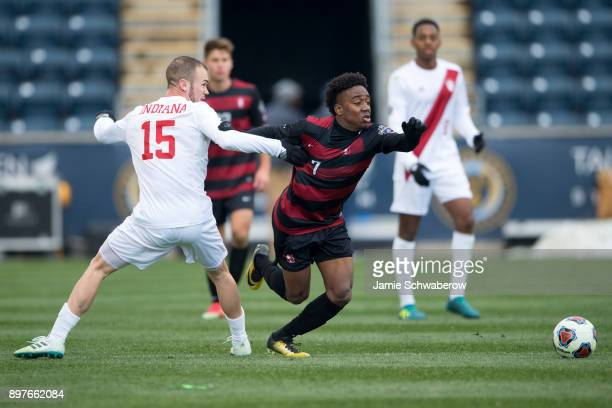 Bryce Marion of Stanford University and Andrew Gutman of Indiana University battle for position during the Division I Men's Soccer Championship held...
