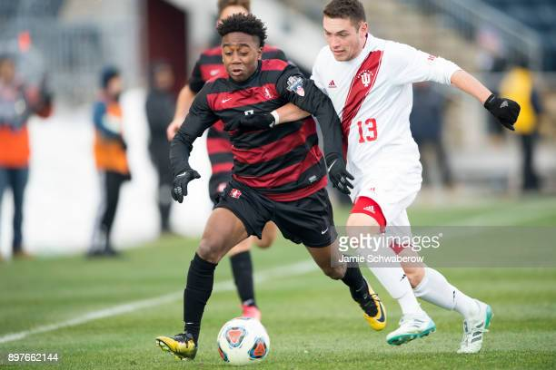 Bryce Marion of Stanford University and Francesco Moore of Indiana University battle for position during the Division I Men's Soccer Championship...
