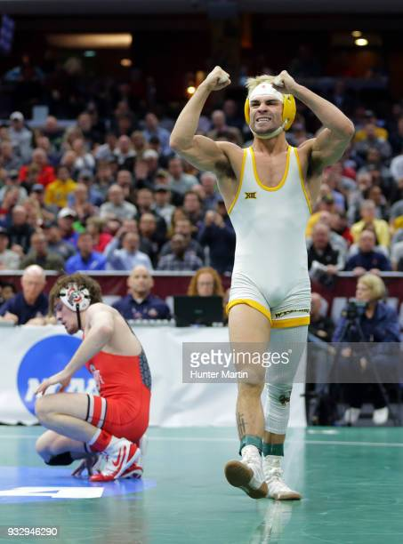 Bryce Meredith of the Wyoming Cowboys celebrates after defeating Joey McKenna of the Ohio State Buckeyes during session four of the NCAA Wrestling...