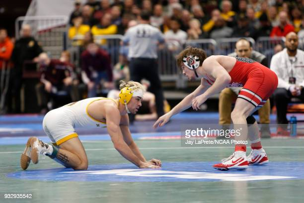 Bryce Meredith of Wyoming wrestles Joey McKenna of Ohio State in the 141 weight class during the Division I Men's Wrestling Championship held at...