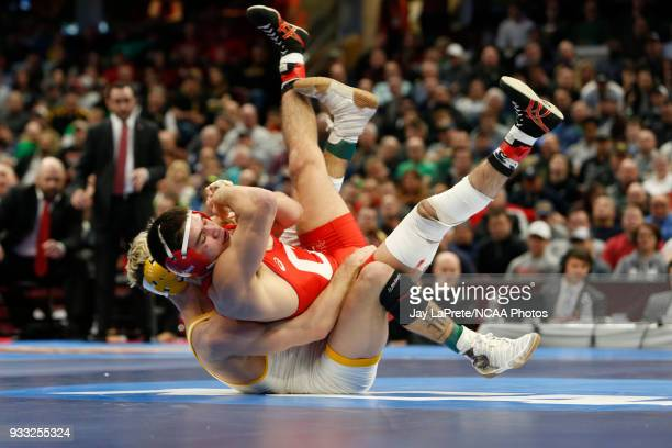 Bryce Meredith of Wyoming wrestles Yianni Diakomihalis of Cornell in the 141 weight class during the Division I Men's Wrestling Championship held at...