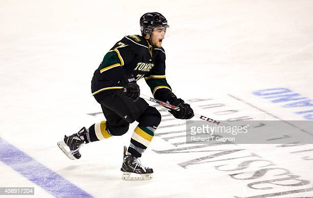 Bryce Milson of the St. Thomas University Tommies skates against the Massachusetts Lowell River Hawks during NCAA exhibition hockey at the Tsongas...