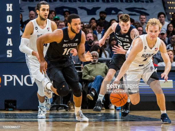 Bryce Nze of Butler pursues Mac McClung of Georgetown during a game between Butler and Georgetown at Capital One Arena on January 28 2020 in...