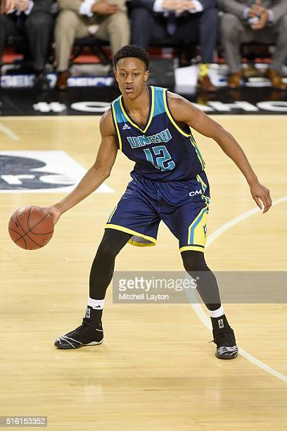 J Bryce of the North CarolinaWilmington Seahawks dribbles the ball during the Colonial Athletic Conference Championship college basketball game...