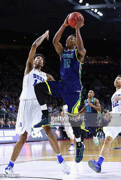J Bryce of the North CarolinaWilmington Seahawks drives to the basket against Brandon Ingram of the Duke Blue Devils in the first half of their game...