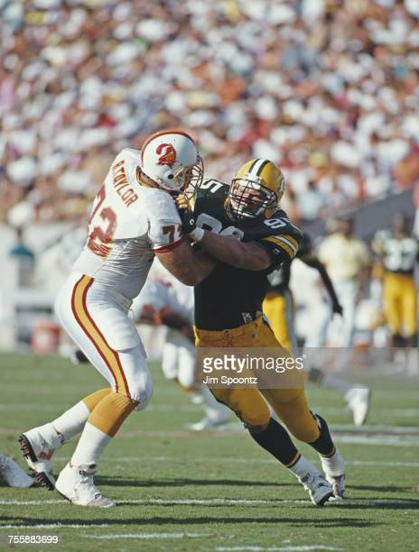 Bryce Paup linebacker for the Green Bay Packers tackles Rob Taylor Offensive Tackle for theTampa Bay Buccaneers during their National Football...