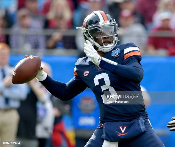 Bryce Perkins of the Virginia Cavaliers looks to pass against the South Carolina Gamecocks during the first half of the Belk Bowl at Bank of America...