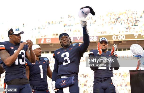 Bryce Perkins of the Virginia Cavaliers salutes the fans after a win against the South Carolina Gamecocks during the Belk Bowl at Bank of America...