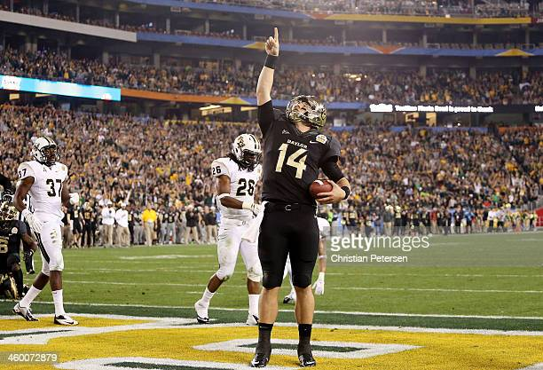 Bryce Petty of the Baylor Bears celebrates a third quarter touchdown against the UCF Knights during the Tostitos Fiesta Bowl at University of Phoenix...