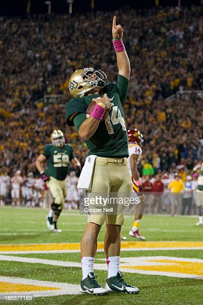 Bryce Petty of the Baylor Bears celebrates after rushing for a touchdown against the Iowa State Cyclones on October 19 2013 at Floyd Casey Stadium in...