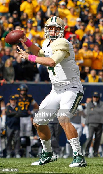 Bryce Petty of the Baylor Bears drops back to pass during the game against the West Virginia Mountaineers on October 18 2014 at Mountaineer Field in...