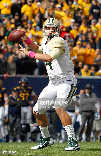 Bryce Petty of the Baylor Bears drops back to pass in the first half against the West Virginia Mountaineers during the game on October 18 2014 at...