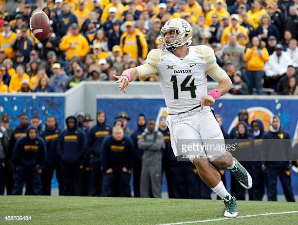 Bryce Petty of the Baylor Bears pitches during the game against the West Virginia Mountaineers on October 18 2014 at Mountaineer Field in Morgantown...
