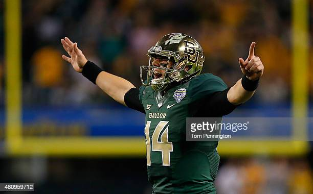 Bryce Petty of the Baylor Bears reacts after throwing a touchdown pass to LaQuan McGowan of the Baylor Bears against the Michigan State Spartans...