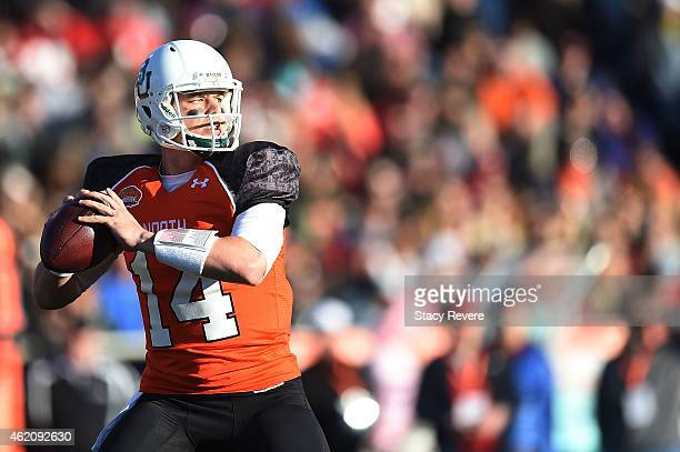 Bryce Petty of the North team drops back to pass against the South team during the second quarter of the Reese's Senior Bowl at Ladd Peebles stadium...