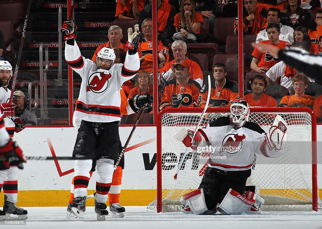 Bryce Salvador #24 and Martin Brodeur #30 of the New Jersey Devils celebrate their 3-1 victory over the Philadelphia Flyers in Game Five of the Eastern Conference Semifinals during the 2012 NHL Stanley Cup Playoffs at Wells Fargo Center on May 8, 2012 in Philadelphia, Pennsylvania. The Devils defeated the Flyers 3-1 to win the series four games to one.
