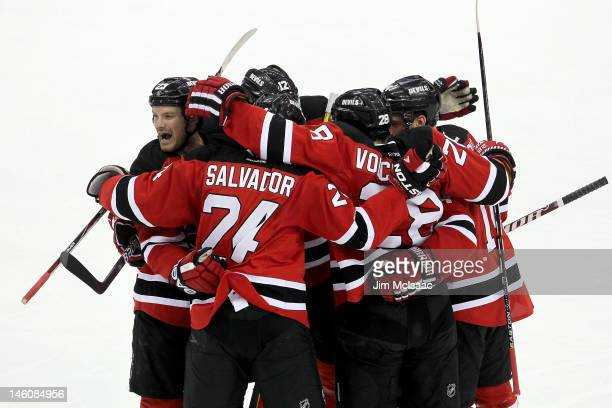 Bryce Salvador of the New Jersey Devils celebrates with teammates after scoring a goal in the second period against the Los Angeles Kings during Game...