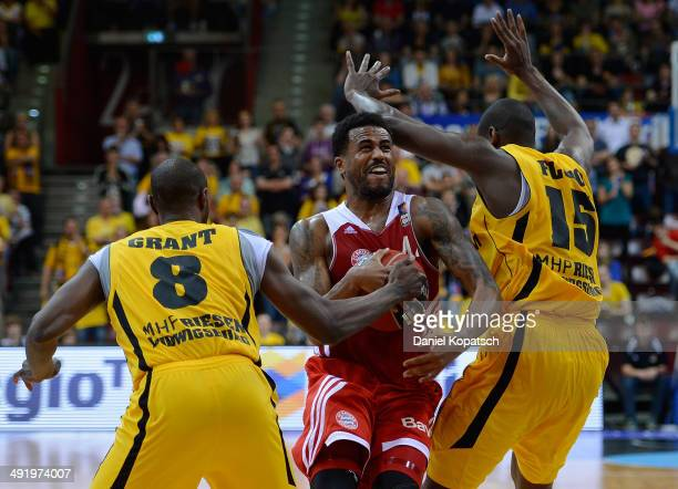 Bryce Taylor of Muenchen is challenged by Keaton Grant of Ludwigsburg and Patrick Flomo of Ludwigsburg during the Beko BBL Playoffs semifinal match...
