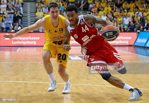 Bryce Taylor of Muenchen is challenged by Michael Stockton of Ludwigsburg during the Beko BBL Playoffs semifinal match between MHP RIESEN Ludwigsburg...