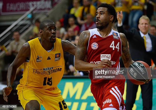 Bryce Taylor of Muenchen is challenged by Patrick Flomo of Ludwigsburg during the Beko BBL Playoffs semifinal match between MHP RIESEN Ludwigsburg...