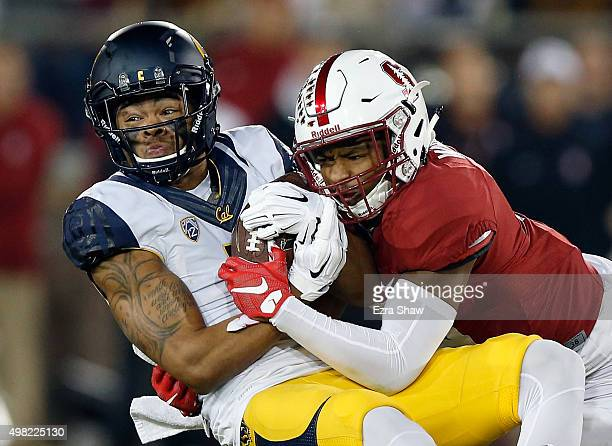 Bryce Treggs of the California Golden Bears is tackled by Kodi Whitfield of the Stanford Cardinal at Stanford Stadium on November 21, 2015 in Palo...