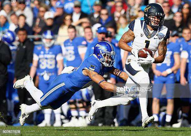 Bryce Treggs of the California Golden Bears pulls in a pass against Brodie Hicks of the Air Force Falcons in the second quarter of the Lockheed...