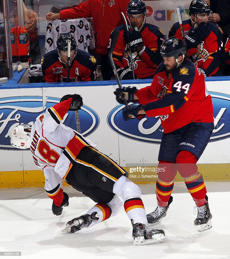 Bryce Van Brabant #48 of the Calgary Flames collides with Erik Gudbranson #44 of the Florida Panthers at the BB&T Center on April 4, 2014 in Sunrise, Florida.