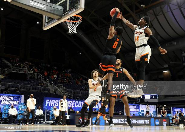 Bryce Williams of the Oklahoma State Cowboys defends the net against Gianni Hunt of the Oregon State Beavers during the first half in the second...
