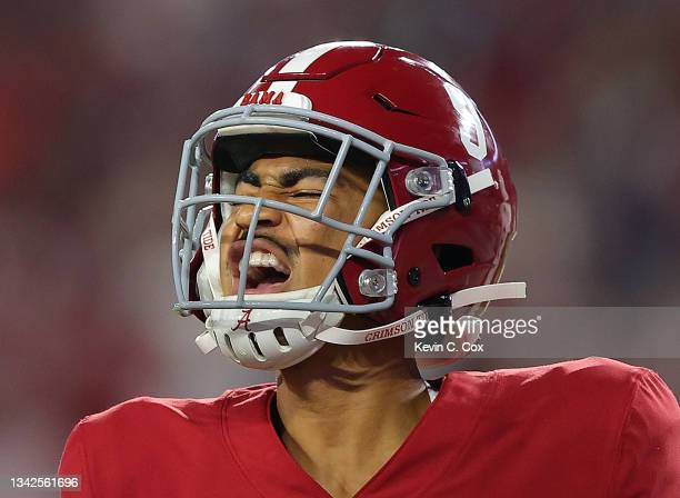 Bryce Young of the Alabama Crimson Tide reacts after handing off for a touchdown against the Southern Miss Golden Eagles during the first half at...