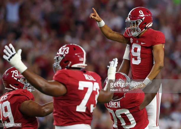 Bryce Young of the Alabama Crimson Tide reacts after passing for a touchdown against the Southern Miss Golden Eagles during the first half at...