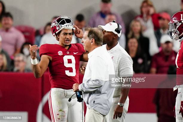 Bryce Young of the Alabama Crimson Tide talks to head coach Nick Saban of the Alabama Crimson Tide during a timeout in the game against Tennessee...
