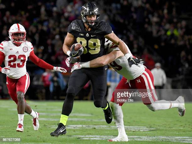 Brycen Hopkins of the Purdue Boilermakers runs with the ball after catching a pass in the second quarter of the game between the Purdue Boilermakers...