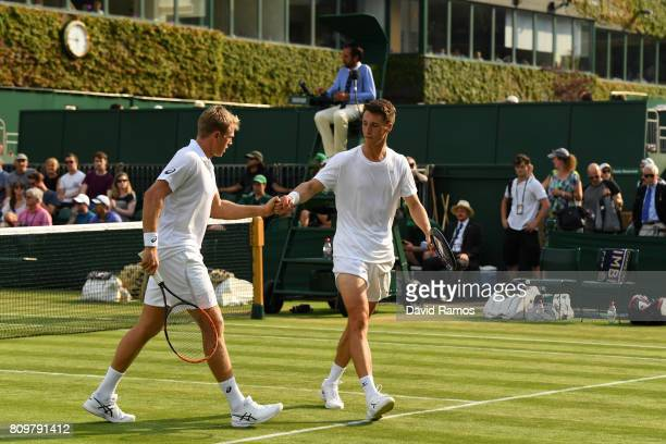 Brydan Klein of Great Britain and Joe Salisbury of Great Britain celebrate a point during the Gentlemen's Doubles first round match against Ken...