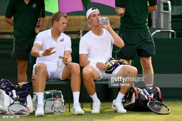 Brydan Klein of Great Britain and Joe Salisbury of Great Britain take a break during the Gentlemen's Doubles first round match against Ken Skupski of...