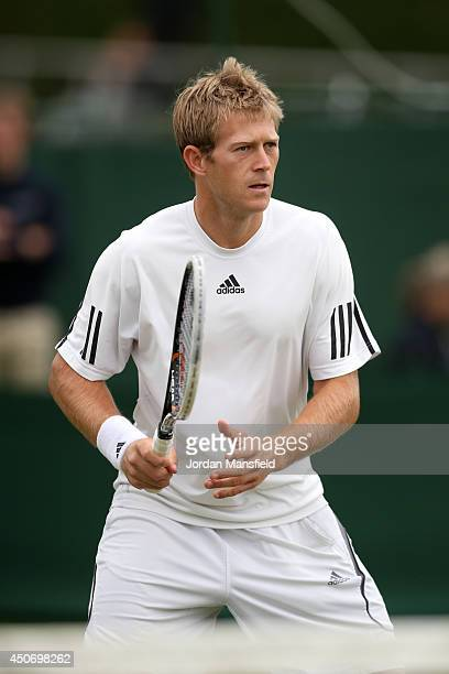 Brydan Klein of Great Britain in action in his first round qualifying match against Maxime Authom of Belgium on day one of the Wimbledon...