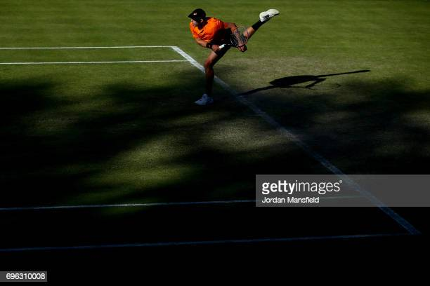 Brydan Klein of Great Britain serves during his Men's Singles second round match against Sam Groth of Australia during day four of the Aegon Open...