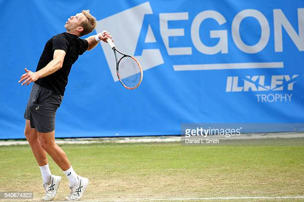 Brydan Klein of Great Britain serves the ball in to play during his match against Grega Zamlja of Slovakia during the Aegon Ilkley Trophy at Ilkley...