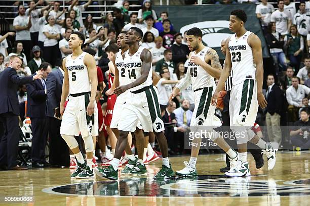 Bryn Forbes Javon Bess Eron Harris Denzel Valentine and Deyonta Davis of the Michigan State Spartans walk to the bench during a timeout late in the...