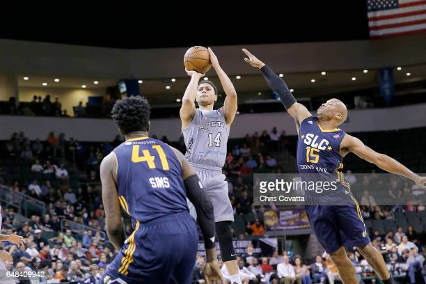Bryn Forbes of the Austin Spurs shoots the ball against Sundiata Gaines of the Salt Lake City Stars at the HEB Center At Cedar Park on March 5 2017...