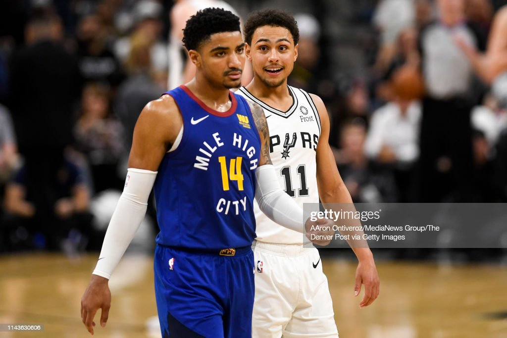 Bryn Forbes of the San Antonio Spurs chirps at Gary Harris of the